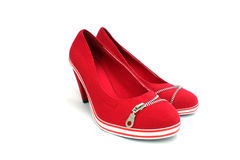 Red shoes decorated by zipper Stock Photos