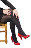Red shoes and female feet. Stock Photo