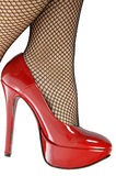 Red Shoes and fishnet stockings Royalty Free Stock Image
