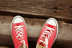 Red shoes on the floor of brown wood. Stock Images