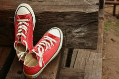 Red shoes on the floor of brown wood. Royalty Free Stock Photos