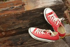 Red shoes on the floor of brown wood. Royalty Free Stock Photo
