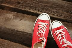 Red shoes on the floor of brown wood. Royalty Free Stock Photography