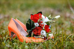Red shoes and flowers Stock Image