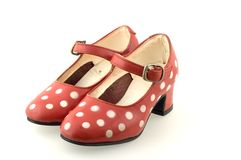 Red shoes for a girl. Polka dot red shoes Royalty Free Stock Photo