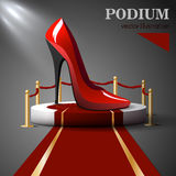 Red shoes with heels standing on podium Stock Image
