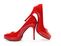 Red shoes. Red high heel shoes on white Stock Images
