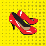 Red shoes with high heels on a yellow background with stars. Stock Photography