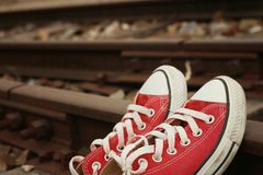 Red shoes leaning on the train tracks. Royalty Free Stock Photography