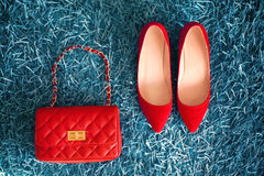 Red Shoes and leather handbag. Women clothes and accessories. Fa Royalty Free Stock Images
