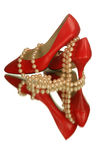 Red shoes with pearls. Pair of red high heel shoes with pink pearls isolated and reflected on white Royalty Free Stock Images