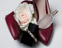 Red shoes and perfume. Over white Stock Photos