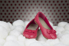 Red shoes with polka dots for girls Stock Photos