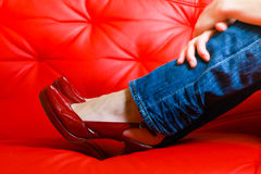 Red shoes on red sofa Stock Photo