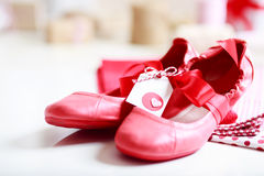 Red shoes with ribbon and heart tag Royalty Free Stock Image