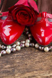Red shoes with rose flower Royalty Free Stock Images