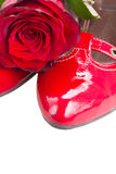 Red shoes with rose flower Stock Photos