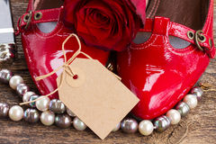 Red shoes with rose flower Stock Image