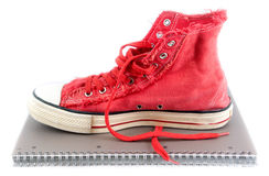 Red shoes on a school notebook. Stock Image