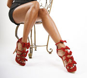 Red shoes on sexy legs Stock Images