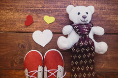 Red shoes son with white teddy bear and necktie. On rustic wooden background, father`s day concept stock photo