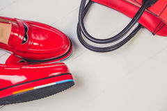 Red shoes, stylish patent leather shoes Royalty Free Stock Photos