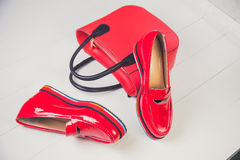 Red shoes, stylish patent leather shoes Stock Photography