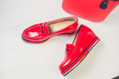 Red shoes, stylish patent leather shoes Stock Photos