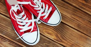 Red shoes on texture wooden base day royalty free stock photography