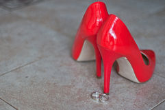 Red shoes and wedding rings Stock Photo