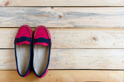 Red shoes on wooden background. Top view/.  Stock Photography