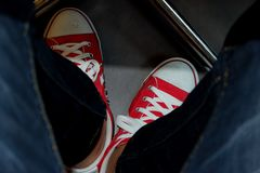 Red shoes that are worn. stock images