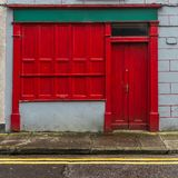 A red shop front in Ireland on a street royalty free stock photography