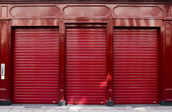 Red shop window. With the blinds pulled down Stock Photo