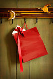 Red shopping bag hanging on hook Stock Image