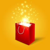 Red shopping bag with magic light fireworks from. It vector illustration