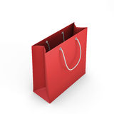 Red shopping bag on a white Royalty Free Stock Photography