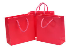 Red shopping bags. A set of three red shopping or gift bags royalty free stock images