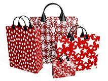 Red Shopping Bags in Bold Prints. 3D illustration of four red festive shopping bags  with bold prints Stock Photo