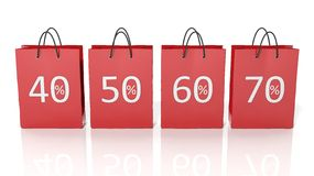 Red shopping bags with discount percentages Stock Photo