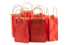 Red shopping bags. Group of red shopping bags on a white background stock image