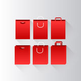 Red shopping bags. With various handles and view angle Royalty Free Stock Photography
