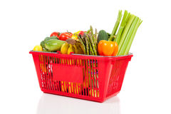 A red shopping  basket with vegetables Stock Photo