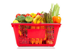A red shopping  basket with vegetables Royalty Free Stock Image