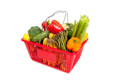 Red shopping basket with vegetables on white Royalty Free Stock Photos