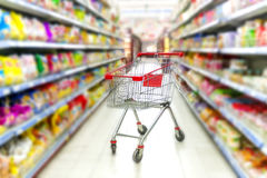 Red shopping cart in supermarket Royalty Free Stock Image