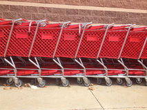 Red Shopping Carts Lined Up Stock Photos