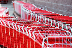 Red shopping carts. Lots of red shopping carts in a row Stock Photography