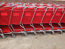 Red Shopping Carts In A Row Royalty Free Stock Photography
