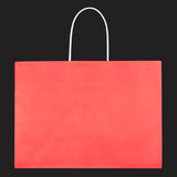 Red shopping paper bag on black texture Stock Images